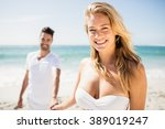 smiling couple holding hands on ... | Shutterstock . vector #389019247