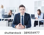 young boss is talking with his... | Shutterstock . vector #389054977