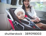portrait of a mother securing... | Shutterstock . vector #389098003