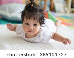asian baby girl  laying on... | Shutterstock . vector #389151727