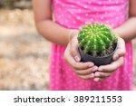Preteen Girl Holding A Pot Of...