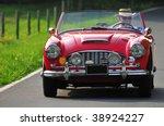 a senior man driving a classic... | Shutterstock . vector #38924227