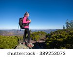 female backpacker reaching her... | Shutterstock . vector #389253073