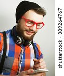 young bearded man with  mobile    Shutterstock . vector #389264767