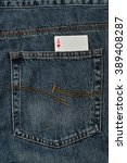 Small photo of An ace of hearts in the back pocket of a denim jeans pants