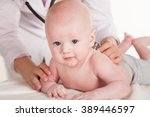 the doctor listens to the baby... | Shutterstock . vector #389446597