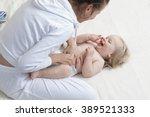 mother changing baby diaper   Shutterstock . vector #389521333