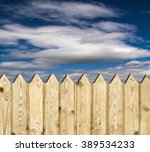 wooden fence   on sky background | Shutterstock . vector #389534233