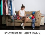 young hipster woman sorting her ... | Shutterstock . vector #389540377