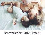 portrait of beautiful mom... | Shutterstock . vector #389849503