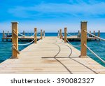 jetty into the blue  | Shutterstock . vector #390082327