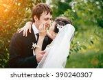 groom and bride together.... | Shutterstock . vector #390240307