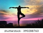 yogi meditating at sunset on... | Shutterstock . vector #390288763