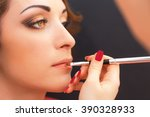 Small photo of Applying lip products in age-related woman's makeup.