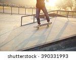 skateboarding legs at skatepark | Shutterstock . vector #390331993