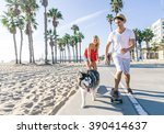 Stock photo beautiful couple skating with dog on ocean walk front during a summer vacation cheerful happy 390414637