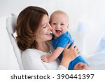 young mother holding her... | Shutterstock . vector #390441397