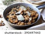 mushroom risotto on vintage pan    Shutterstock . vector #390497443