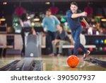bowlingball rolls towards the... | Shutterstock . vector #390507937