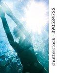 Woman Swimming Underwater Sea...