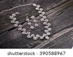 necklace and earrings on a... | Shutterstock . vector #390588967