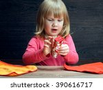 Small photo of Little girl is learning to put things carefully - towels. Concept - teach your child the accuracy, accustom to order