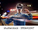 Stock photo double exposure man wearing virtual reality goggles night city 390641047