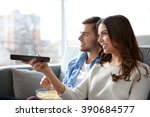 young couple watching tv on a