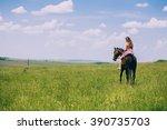 Girl Riding A Horse On A Summe...