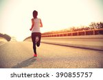young fitness woman runner... | Shutterstock . vector #390855757