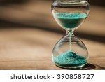 hourglass on wooden background. | Shutterstock . vector #390858727