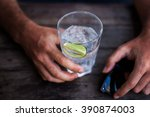 juice with lime in the man... | Shutterstock . vector #390874003