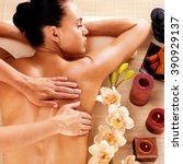 adult woman in spa salon having ... | Shutterstock . vector #390929137
