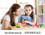 mother and child daughter at... | Shutterstock . vector #390989263