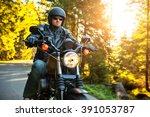 Motorcyclist Riding A Chopper...