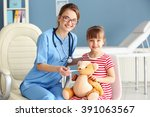 Doctor Checking Little Girl's...