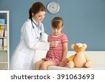 Doctor Examining Girl With...