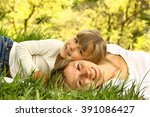 mom and her little daughter lie ... | Shutterstock . vector #391086427
