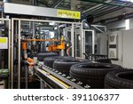tyre production machine conveyor | Shutterstock . vector #391106377