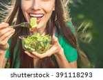 woman eating healthy salad from ... | Shutterstock . vector #391118293