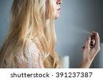 A Blond Girl Spray On Perfume