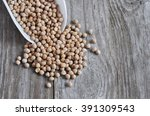the dry chickpeas un the wood... | Shutterstock . vector #391309543