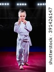 Small photo of Little girl aikido fighter at sports hall
