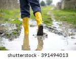 human leg with yellow muddy... | Shutterstock . vector #391494013