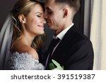 romantic newlyweds hugging in... | Shutterstock . vector #391519387