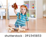 happy child playing with toy... | Shutterstock . vector #391545853