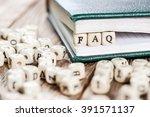 word faq written on a wooden... | Shutterstock . vector #391571137