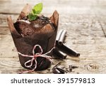 chocolate muffin with mint on a ...