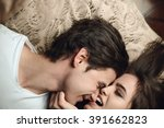 beautiful brunette girl biting... | Shutterstock . vector #391662823