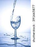 water splashing from glass...   Shutterstock . vector #391665877